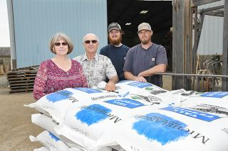 Rusty Rae/News-Register##Gretchen and Steve Jones are in the process of retiring from their Select Seed farm, which has been in the family for 100 years. To their left is grandson Nathan Jones and warehouse manager Jason Galbreath.