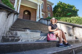 Rockne Roll/News-Register##Idalis Nieves, on the steps of Linfield College's Pioneer Hall, is hoping to revitalize her Harry Potter-themed club this year.