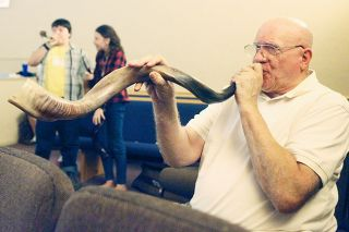 Rockne Roll/News-Register##Arlen Peacock sounds his shofar during a service honoring Rosh Hashanah on Monday at Northwest Harvest Church in McMinnville.
