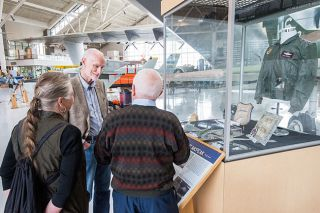 Marcus Larson/News-Register##General Merrill  Tony  McPeak chats with old schoolmate Ted Sieckman and his wife, Arlette, as they look over half the new display honoring the former Air Force chief of staff at the Evergreen Aviation Museum. The display of uniforms and memorabilia takes up two glass cases and includes a Vietnam-era F-100F, like McPeak flew over the Ho Chi Minh Trail.
