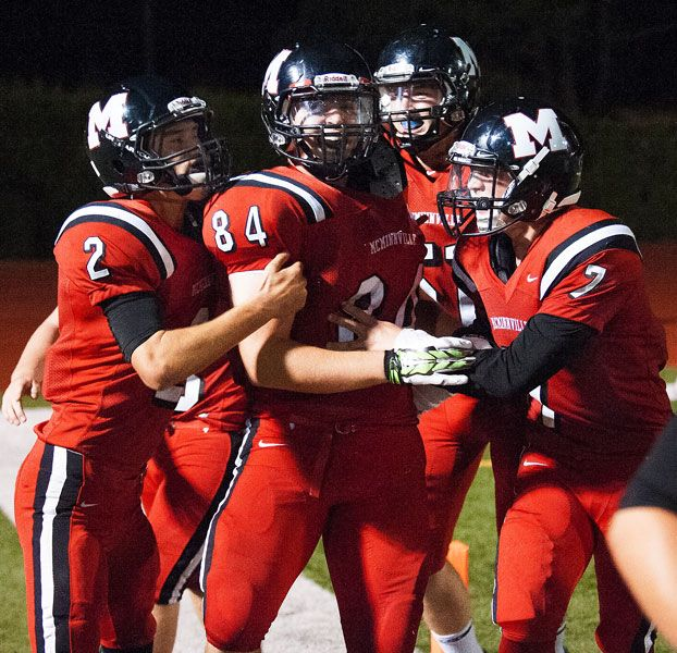 Marcus Larson/News-RegisterMcMinnville s Walter Stahl (2), Taylor Brown (51) and Jesse Medley (7) celebrate with Colton Heidt (84) after Heidt caught a 28-yard touchdown pass in the fourth quarter against Sprague.