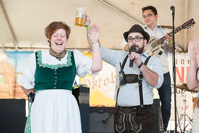News-Register file photo##Kaite Weaver is honored with a toast and applause after winning a prize in the lederhosen contest during last year's Oktoberfest in Newberg.