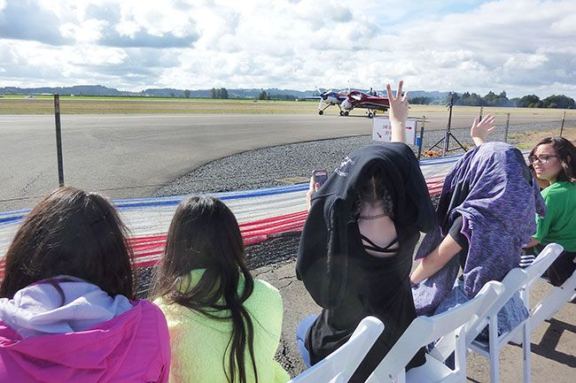 Starla Pointer / News-Register##Fifth-graders wave at  pilot Jeff Boerboon as he taxis his Yak 110 out to the runway for his part of the show.