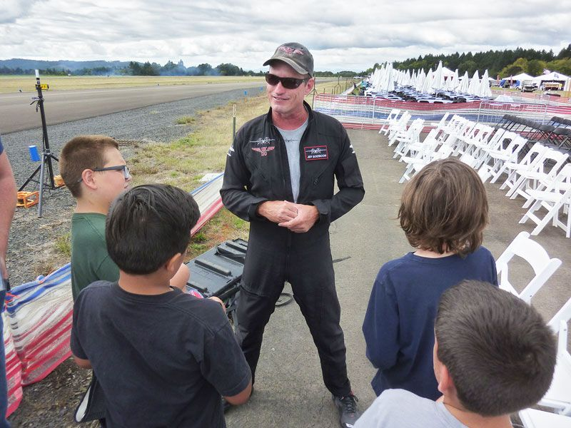 Starla Pointer / News-Register##Acrobatic pilot Jeff Boerboon  talks to McMinnville students, telling them his plane, the Yak 110, was created by combining the fuselages of two Yak 55s.