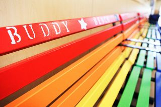 Rockne Roll / News-Register##Lowe s employees painted the benches in bright primary colors to appeal to youngsters.