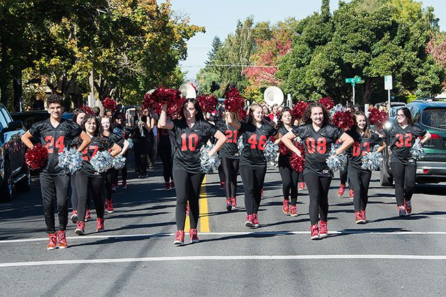 Marcus Larson / News-Register##Mac Mac High s dance team leads the parade as students march through downtown to show their school pride.