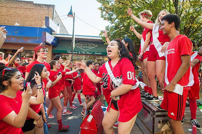 Marcus Larson / News-Register##McMinnville High School juniors cheer loudly as they celebrate class and school pride during the annual homecoming parade Thursday.