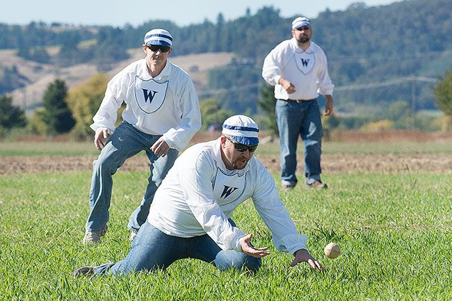 Marcus Larson/News-Register##Shortstop Matt Newton goes low to field a ball during a vintage baseball game at the Yamhill Valley Heritage Center on Saturday. The game used the original rules for baseball, which differ with the modern rules in many respects.