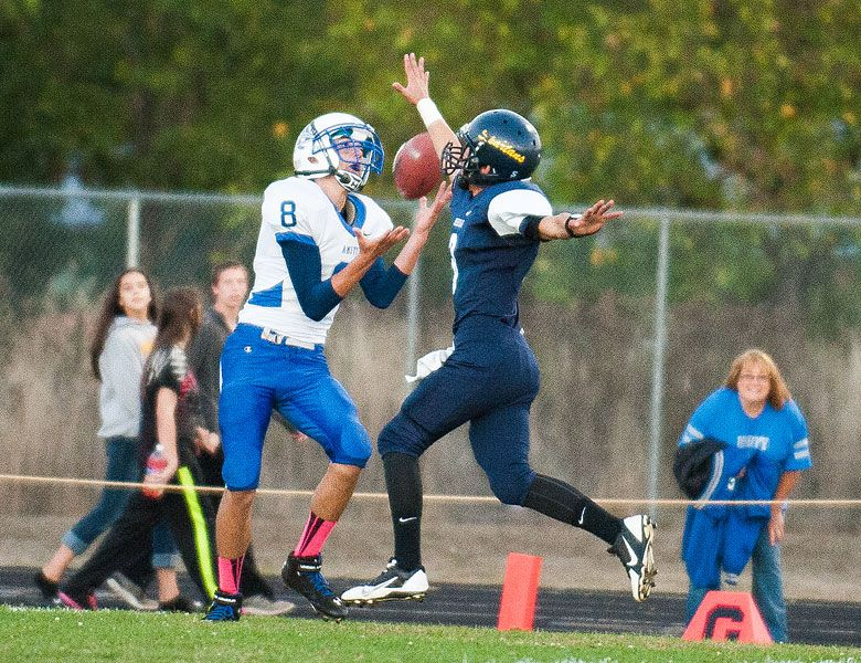 Marcus Larson/News-RegisterClint Hatch of Amity (8) catches a touchdown pass in the first quarter as Sheridan s Miguel Diaz (3) defends.