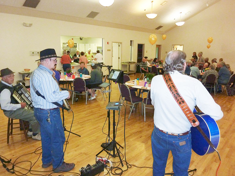 Starla Pointer/New-Register##Johnny's Country Western Band play a tune during the celebration marking the 50th anniversary of the Friends of the McMinnville Senior Center.