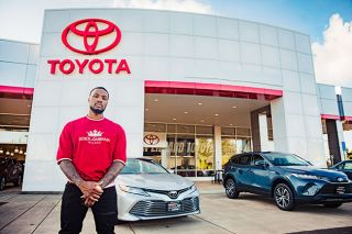 Photo courtesy Maddie Rubalcava##Damiam Lillard outside the Toyota dealership he now co-owns in McMinnville.