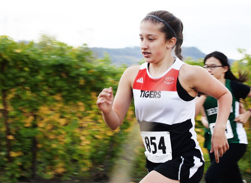 Rockne Roll/News-Register##Grace Armstrong of the Yamhill-Carlton Tigers turned in a fourth place finish and a personal best.