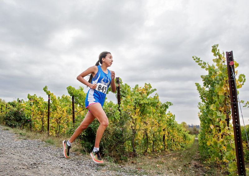 Rockne Roll/News-Register##Elonor Alba makes tracks through the Keeler Estates Vineyard.