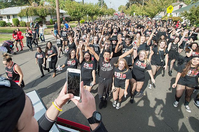 Marcus Larson/News-Register##McMinnville High school's yearly homecoming parade is lead down Evans Street by the senior class.