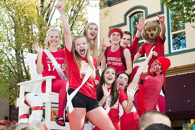 Marcus Larson/News-Register##The Junior homecoming court cheers as it travels down Third Street Thursday afternoon.