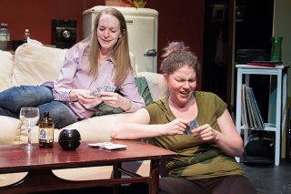Marcus Larson/News-Register##Callie (Lesli Lucier) and Sara (Brittney Hancock) enjoy a night of playing cards and chatting about problems in their lives.