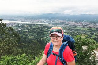 Submitted photo##Tim Youngberg snapped a photo of his mother, Esther, as she paused on a high-altitude section of the trail. She said she loved the views of valleys, but wasn't so happy about the steep inclines she had to climb. By the end of her walk, though, she could scale them without huffing and puffing, she said.