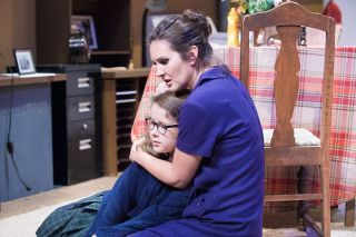 "News-Register file photo##Susy (Holly Beaman), who is adjusting to her blindness, comforts a neighbor girl (Molly Hare) in Gallery Theater's production of ""Wait Until Dark."""