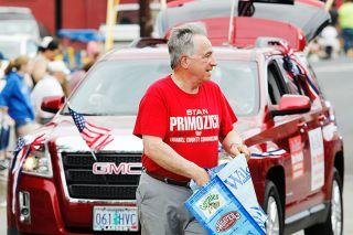 News-Register file photo##County Commissioner Stan Primozich walks along the Sheridan parade route.