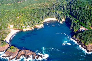 Image: Bryce Buchanan/ODOT##An aerial shot of Whale Cove shows the location of Bootlegger Rock and the beach on which the booze was buried.
