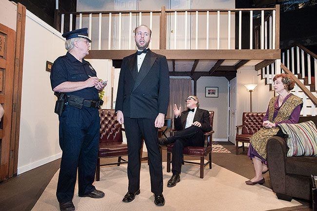 "Marcus Larson/News-Register##In Gallery Theater's production of ""Rumors,"" Ken Gorman (John Hamilton) tries to explain to Officer Welch (Nolan Chard) why he and his guests were being so loud during a party."