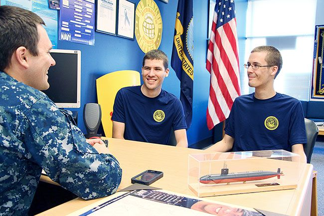 Submitted photo##Ben and Tim Dority talk with Petty Officer Brian Hoeger, recruiter at the Navy Recruiting Station in McMinnville.