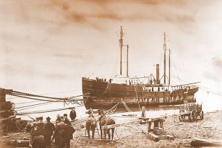 Image: Oregon Historical Society##In the spring of 1901, Allen & Roberts crews work to get the Columbia Lightship No. 50 off the beach and on its way through some nearby woods to the Columbia River.