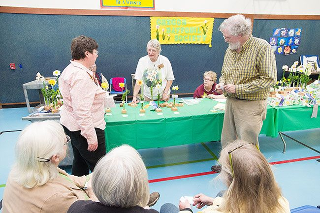 News-Register file photo##Judges admire the best of show during this year's Daffodil Festival. The festival, which ran 21 years, is being discontinued.