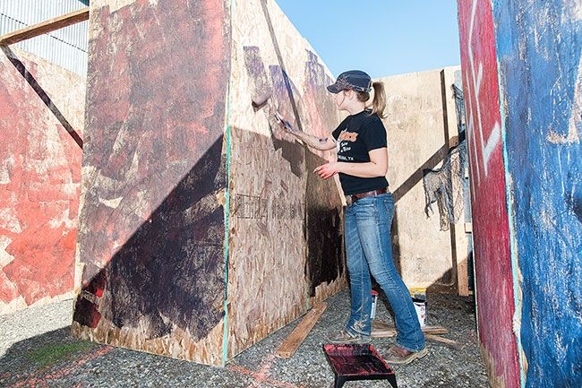Marcus Larson/News-Register##Kaity Scott mixes colors, such as red and black, to add a frantic feeling to the