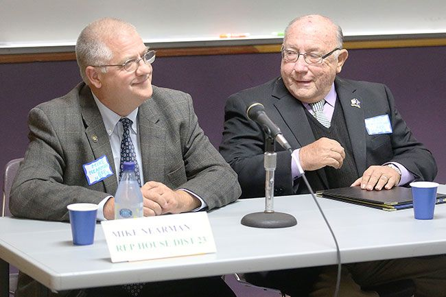 Rockne Roll/News-Register##Rep. Mike Nearman, left, and his challenger, former Rep. Jim Thompson, chat prior to the National Alliance on Mental Illness Yamhill County Affiliate candidates' forum held at the McMinnville Public Library on Thursday, Oct. 6.