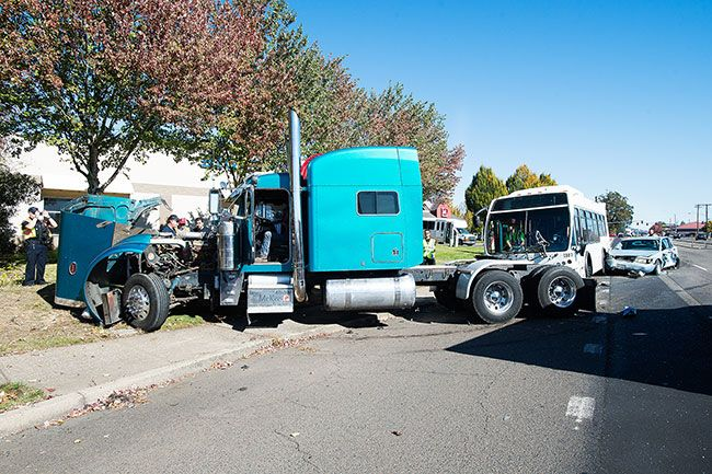 Marcus Larson / News-Register##A tractor-trailer rig, a small sedan and a YCTA bus collided about 12:30 p.m. Tuesday in northeast McMinnville.