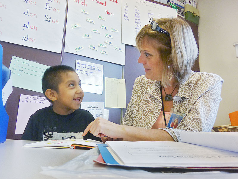 Starla Pointer/News-Register##Second-grader Adrian Angel Reyes and teacher Mary Morton delight in his growing reading skills.