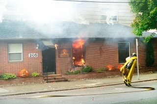 Paul Daquilante / News-Register##Firefighters attack the blaze at Second and Ford streets Tuesday morning.