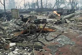 Submitted photo / Lindsay Fowler##Little remains of the home in wildfire-ravaged Coffey Park, a neighborhood in Santa Rosa, of a high school friend of Linfield student Lindsay Fowler.