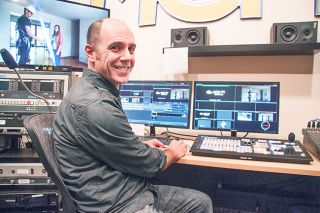 Rockne Roll/News-Register##Phil Guzzo at an editing bay at McMinnville Community Media, where he is a digital video specialist. His science-fiction film is a selection in this weekend's McMinnville Short Film Festival.