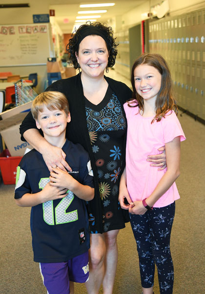 Rusty Rae/News-Register##Fleckenstein with her children, Charlie and Carolyn. She frequently volunteers in their classrooms at Memorial Elementary School.