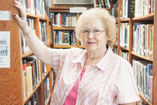 Rockne Roll/News-Register##Alice Wicks has served as head of the Amity Public Library since 2011. She started as a volunteer 25 years ago.