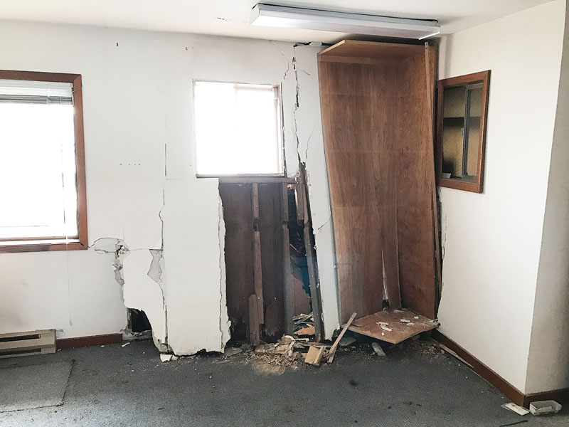 Marcus Larson / News-Register##The crash broke a water line, causing additional damage inside. Modems and other equipment was ruined.