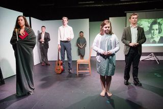 "Marcus Larson/News-Register##Amity High School students pay homage to victims of the Holocaust during the final scene of their play, ""And Then They Came for Me."" The show runs Nov. 1 to 3."