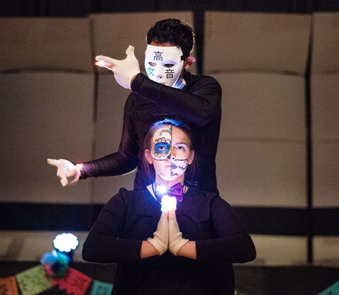 Marcus Larson/News-Register##Rafael Morales and Andrea Keleher perform a light dance at the McMinnville Day of the Dead celebration on Saturday.