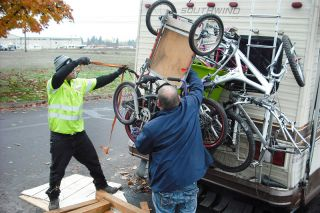 Tom Henderson/News-Register##Omar Gonzalez of Gales Towing & Recovery in McMinnville, left, gets some help from Frank Cochrane as he prepares to tow Cochrane s RV off Marsh Lane. The RVs along the street had to leave Tuesday so McMinnville Water & Light crews would install new street lights.