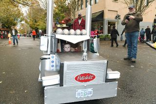 Rusty Rae / News-Register##Travis McKee of Amity celebrates Halloween in downtown McMinnville with his custom-built truck. His dad, Bryce, drives a Peterbilt for a living. But it was his mother, Sydnee, who built Travis s truck.