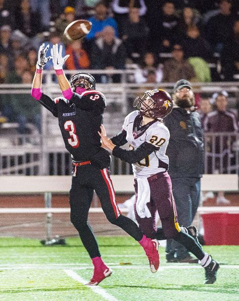 Marcus Larson/News-Register##McMinnville wide receiver Kadin Wilson (3) reaches for a pass during the Grizzlies  28-20 loss to Forest Grove Friday night.