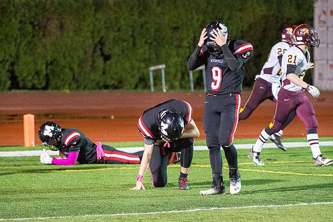 Marcus Larson/News-Register##McMinnville players react following the Grizzlies  28-20 loss to Forest Grove Friday night at Wortman Stadium.