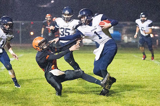 Marcus Larson/News-Register##Sheridan wide receiver Justin Stauffer (1) stiff-arms a defender during the Spartans  22-12 loss to Willamina Friday evening at Glen Larkin Field.
