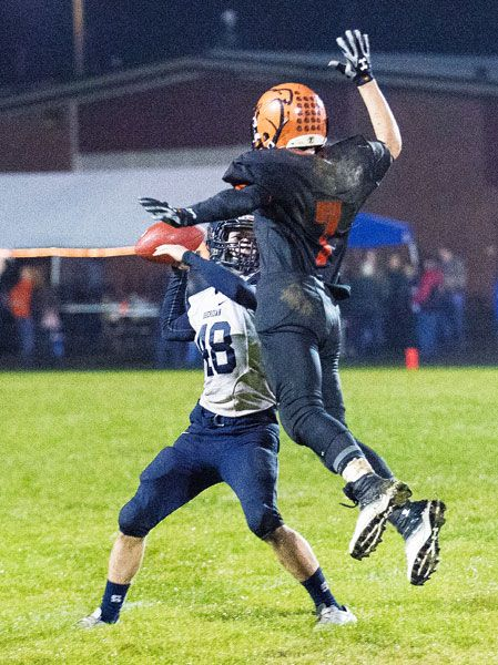 Marcus Larson/News-Register##Willamina s True Gibbons (7) jumps to block a pass attempt from Sheridan s Jackson Meyer (48) Friday night.