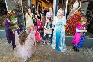 Marcus Larson/News-Register##Princesses from a number of faraway lands hand out candy at Twist Salon.