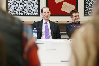 Rockne Roll / News-Register##U.S. Sen. Ron Wyden listens to Dayton High School students talk about their Innovations Academy, a new way of learning set up more like a tech business than a traditional classroom..