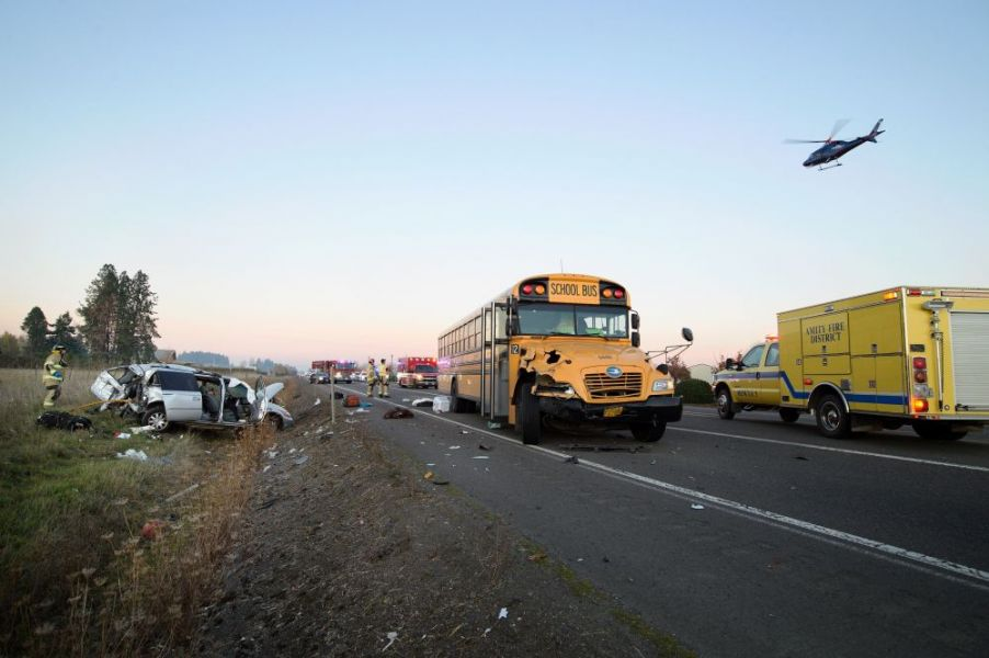 Marcus Larson/News-Register##Life Flight arrives to Durham Road southwest of McMinnville. Occupants of a van that collided with a school bus were seriously injured. No injuries of riders on the bus were initially reported.the scene of a crash Monday evening on Highway 18 near