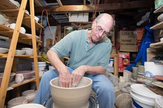 Marcus Larson/News-Register##In his backyard studio, Bill Boyson uses his potter's wheel to form a large pot. The retired Willamina art teacher has been participating in the Coastal Hills Art Tour for about 20 years.